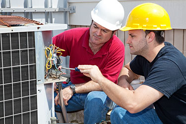 man in red shirt training man in black shirt   Tips for New HVAC Technicians   Adrian Steel