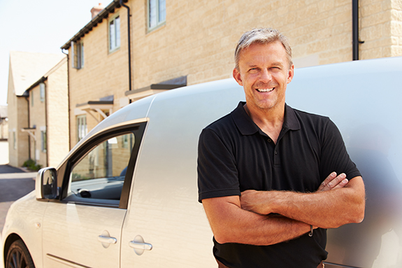 middle aged tradesman standing by a van | General contractor trade package | Adrian Steel