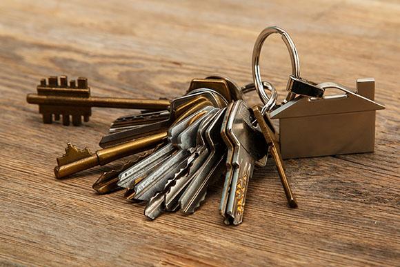 bunch of different keys on wooden surface   Cargo van organization   Adrian Steel