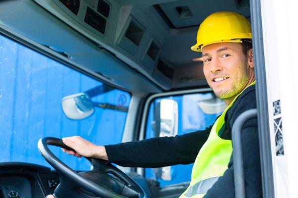 driver operating truck on job site | Reducing Fleet Driver Distraction | Adrian Steel