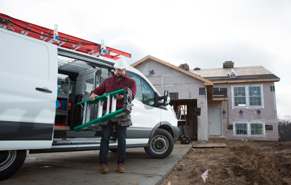 Man removing ladder from work van